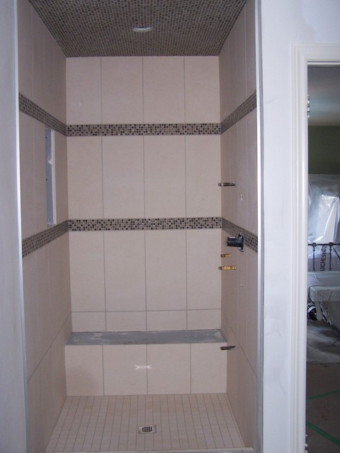 Shower with glass mosaics borders and ceiling