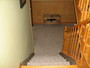 Two toned interior foyer/steps.