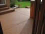 Spiced Rum stone install over cracked concrete patio.