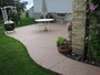 Salmon colored stone over concrete walkway and patio.
