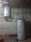 a comparison of a tankless, to a hot water tank