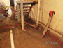 Removing earth and original floor to the level of the bottom of the footing