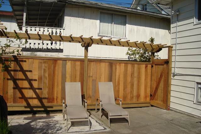 Rough cedar fence with arbor