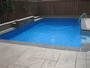 photo of Pool, bar counter, retaining walls, cabana, pergola, landscaping from a Backyard Getaways Inc review