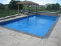 photo of Pool, waterfeature, stonework decking, woodwork from a Backyard Getaways Inc review