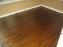 photo of hardwood refinishing (minor repairs) and darker stain from a NewRidge Refinishing review