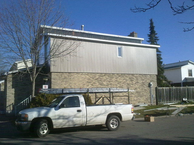 "photo of 1½"" (R9) Insulation, Siding, Sofit, Facia & Eavestroughs. from a Westwood Aluminum review"