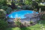 photo of In-ground pool and landscaping from a CLASSIC POOLS & LANDSCAPING INC. review