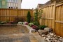 cedar privacy fence with retaining walls and armor stones