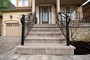 wrought iron railings with flagstone interlocking in toronto