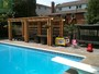 toronto interlocking pool deck with cedar pergola