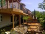 2 level deck with pergola, wrought iron railings and flagstone walkout basement