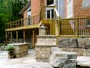 Armor stone landscaping with cedar deck and interlocking in Toronto