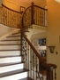 Two tone stair case with wrought iron pickets spindles.JPG