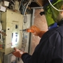 I use arc flash protection to safely inspect electrical panels
