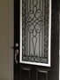 photo of Wrought iron door insert from a What A Pane review
