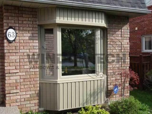 Bay window with vinyl siding for Vinyl bay window