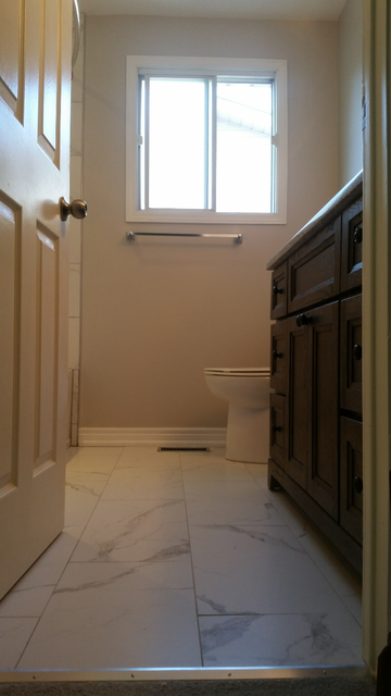 Review of hawkeye 39 s renovations bathroom renovation in for Renovation review