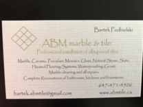 ABM Tile and Marble's logo